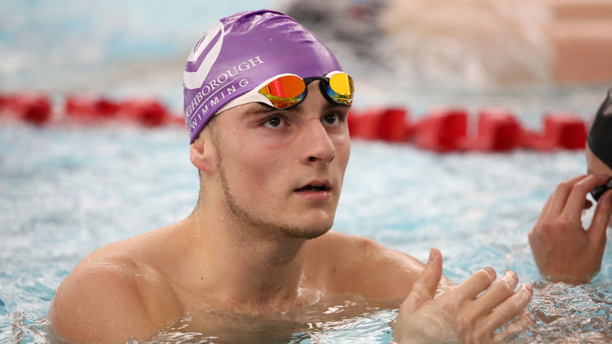 Elliot Clogg wearing a Loughborough University cap during a swimming training session in 2018
