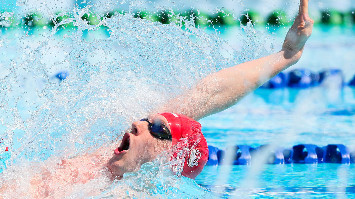 Luke Greenbank swimming backstroke at the Gold Coast 2018 Commonwealth Games