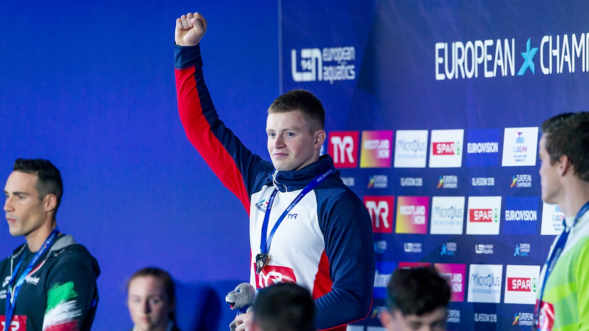 Adam Peaty on the podium after winning gold in the 50m Breaststroke at the 2018 European Championships