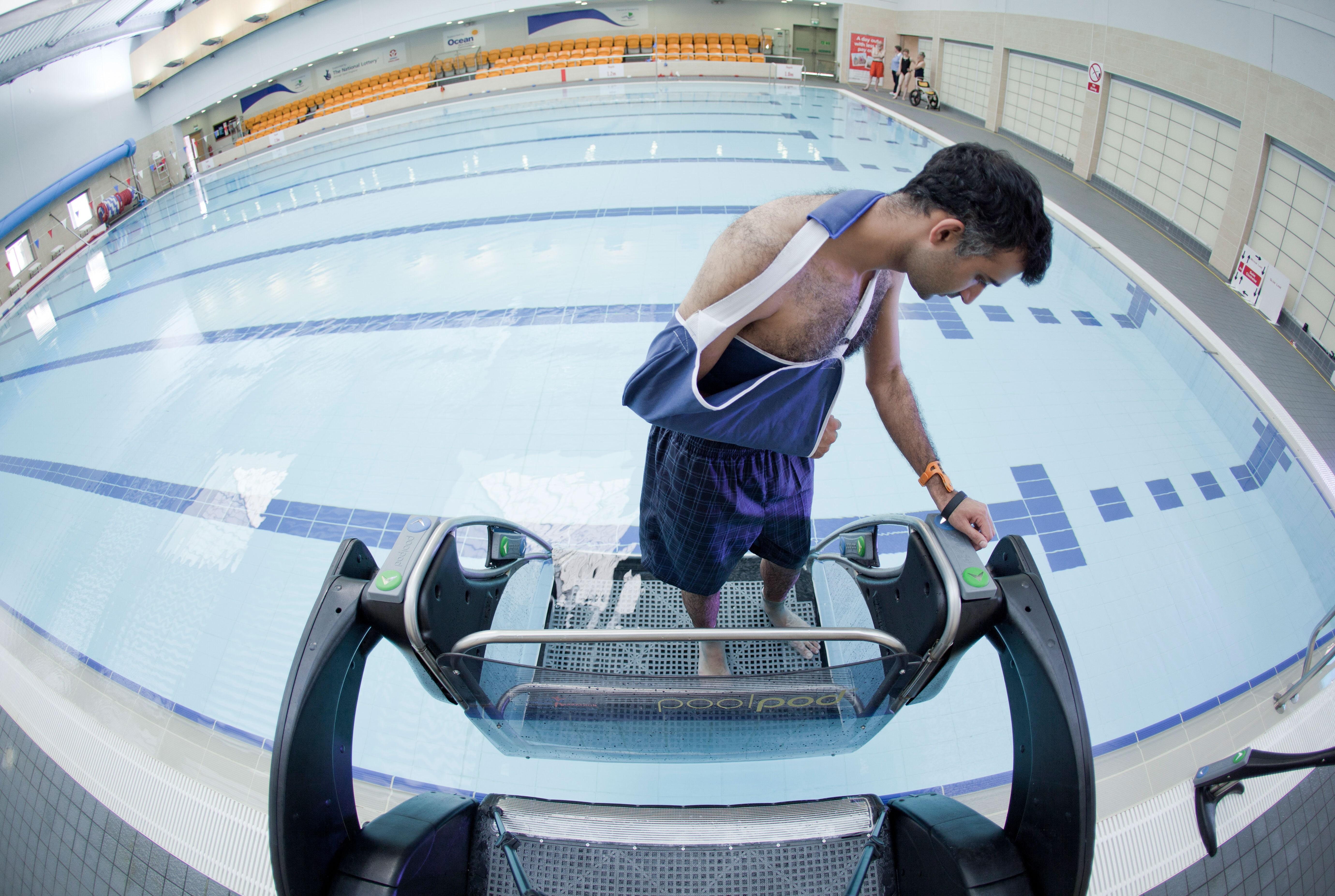 Man using Poolpod to access pool