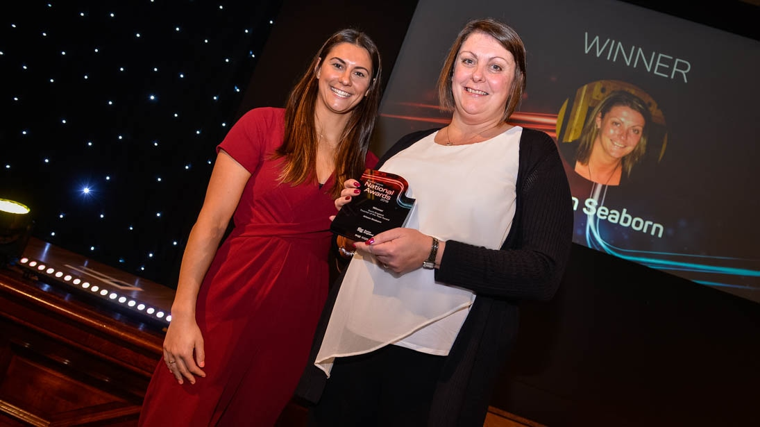 Alison Seaborn receives her Swim England Teacher of the Year award from Aimee Willmott