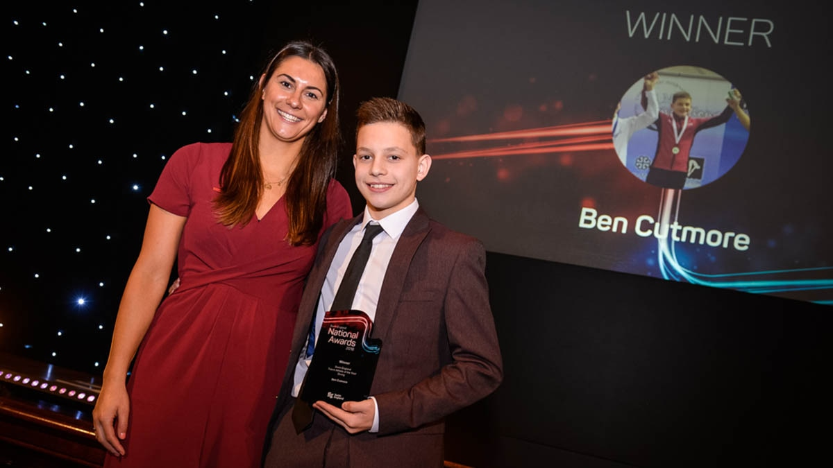 Ben Cutmore receives the Swim England Talent Athlete of the Year Award for Diving from Aimee Willmott