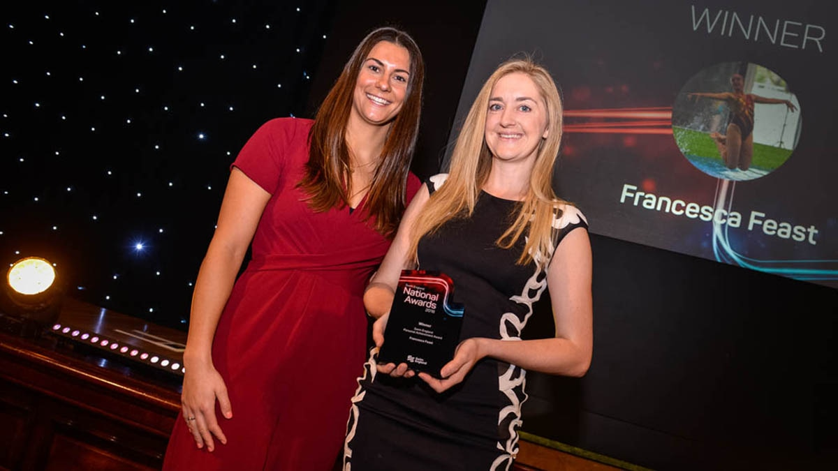 Francesca Feast receives her wim England Personal Achievement Award from Aimee Willmott