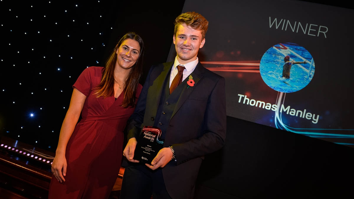 Thomas Manley receives his award from Aimee Willmott