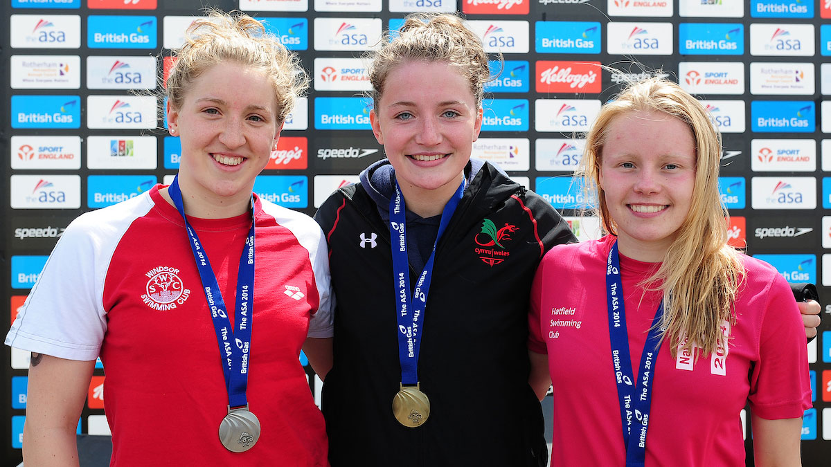 Swansea Aquatics swimmer Ellena Jones on top of the podium after winning 3km gold at the 2014 National Open Water Champs