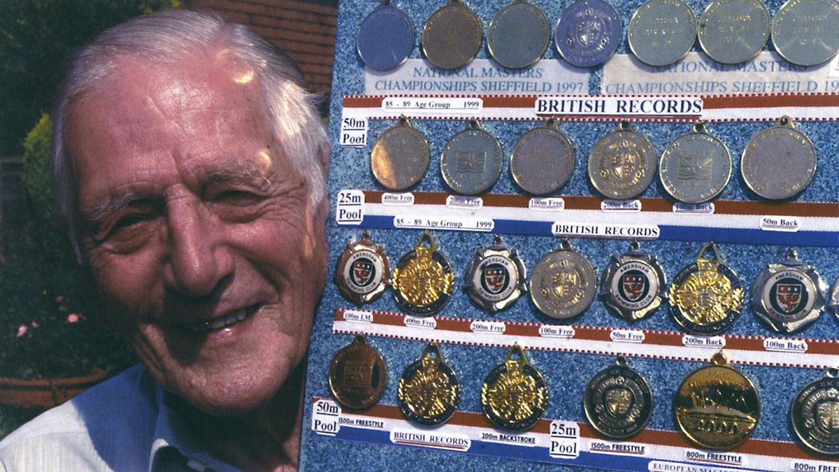 John Harrison with his swimming medals in 2004