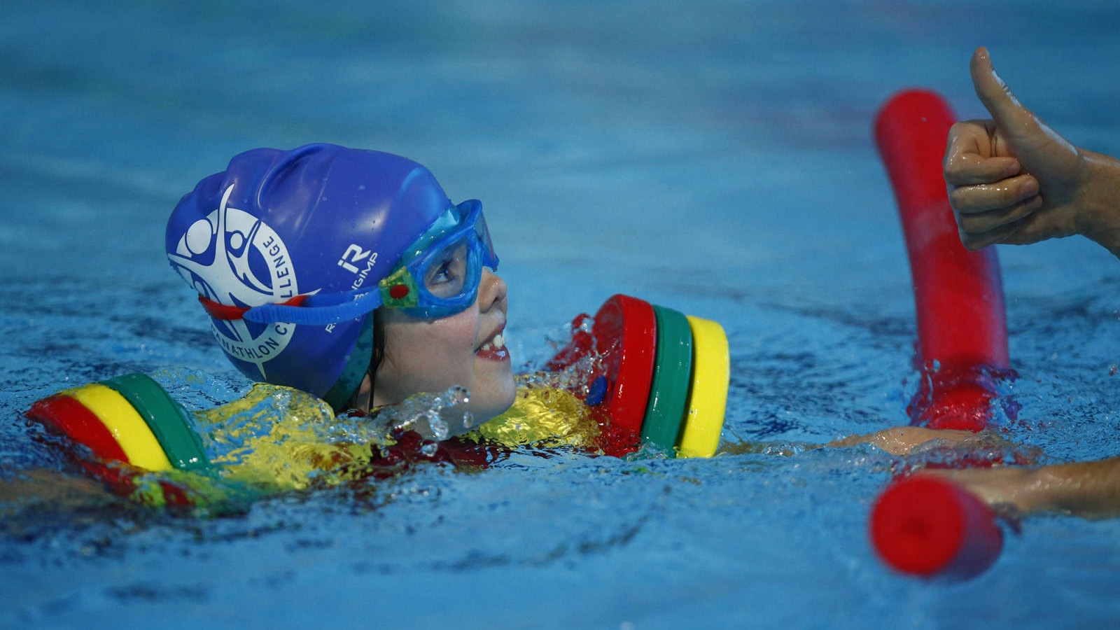 A young pupil from Treetops School in Grays, Essex, competes at the Aquatics Centre