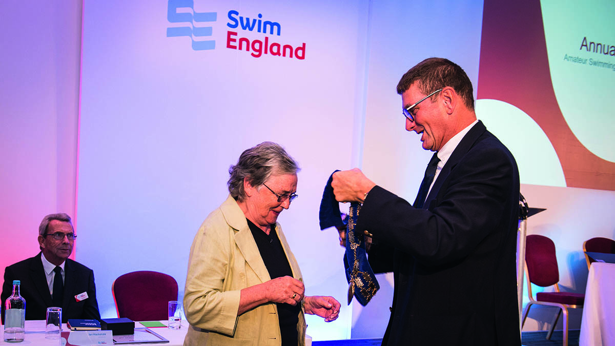 Liz Sykes is presented with the Swim England president's chain by the outgoing president Richard Whitehead