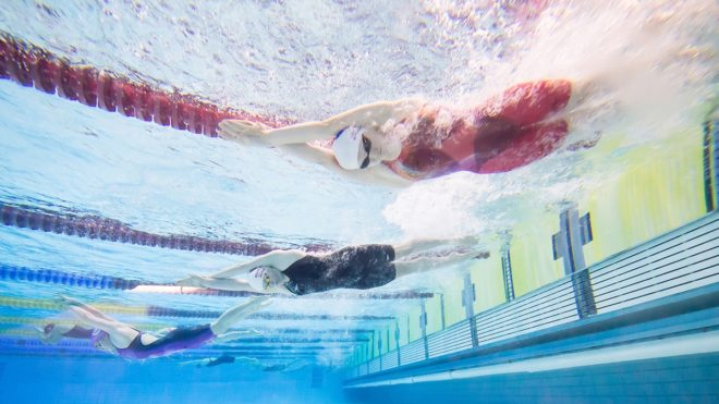 Image of swimmers underwater. Used for Jane Nickerson action plan podcast.