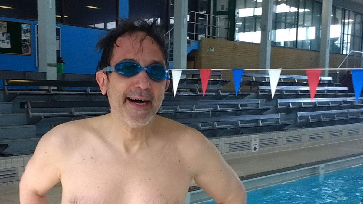 Henri says swimming has helped alleviate his chronic pelvic pain.