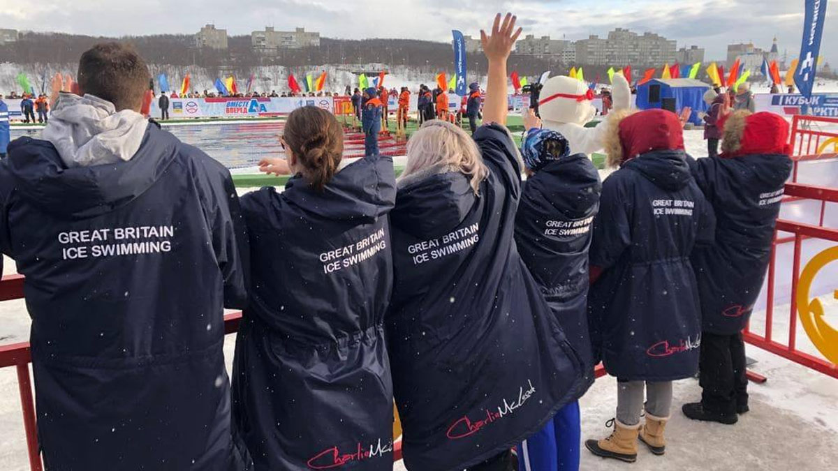 Team GB swimmers support their teammates in freezing conditions.