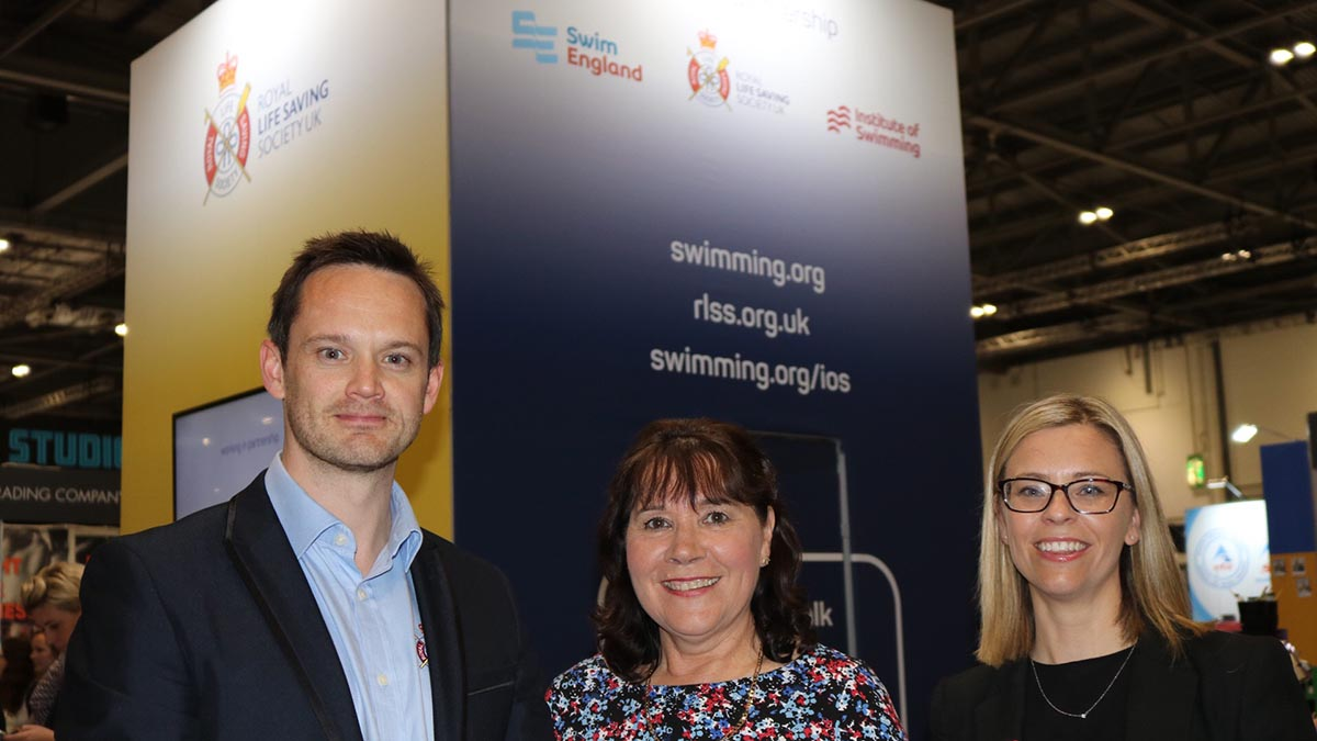 Swim England and RLSS UK have announced a new partnership at Elevate. Pictured, from left, are Lee Heard, director of partnerships for RLSS UK, Swim England chief executive Jane Nickerson and Rebecca Cox, the managing director of the Institute of Swimming