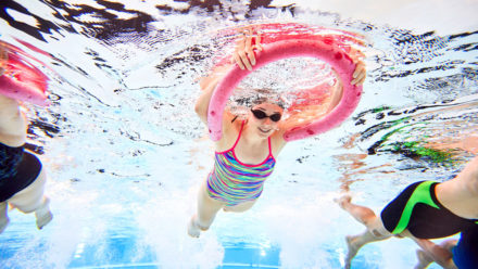 How does swimming affect common skin conditions