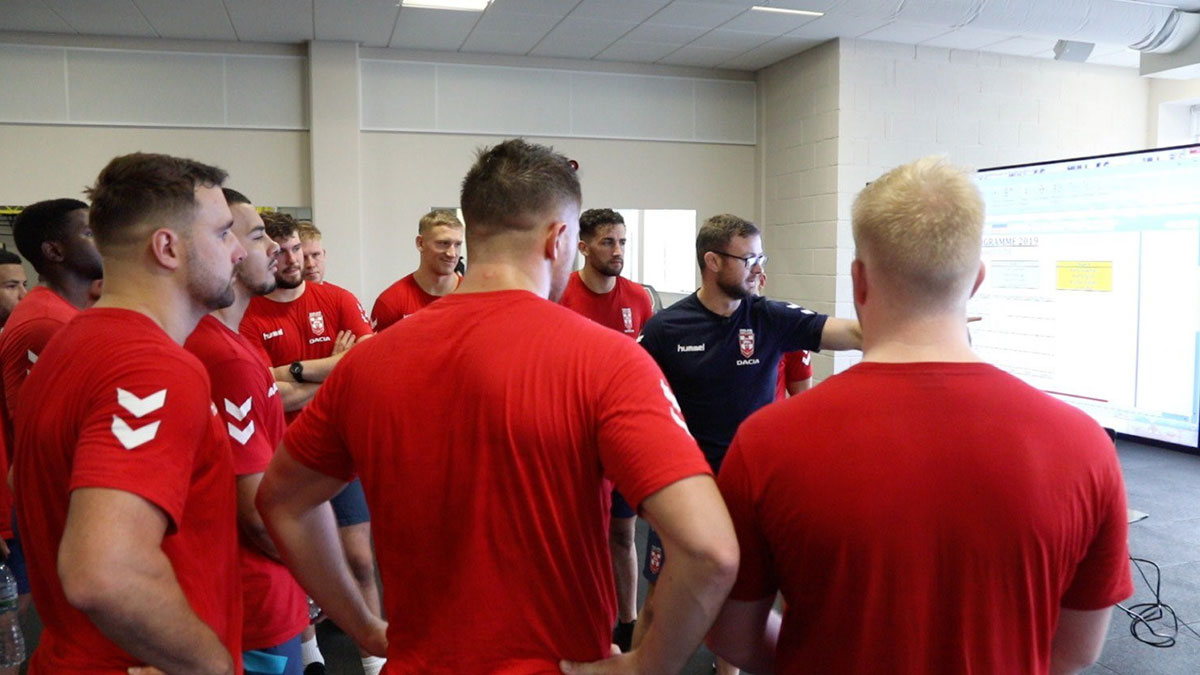 Adam Whitney with England Knights rugby league players
