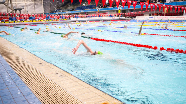 Swimmers training and warming up at County Team Champs. Used for article about holding your breath in training.