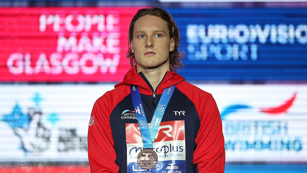 Luke Greenbank on the podium at the European Short Course Championships after winning bronze in the 200m Backstroke