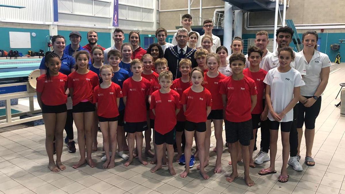 Swim England Team Z divers with Swim England president Ian Mackenzie