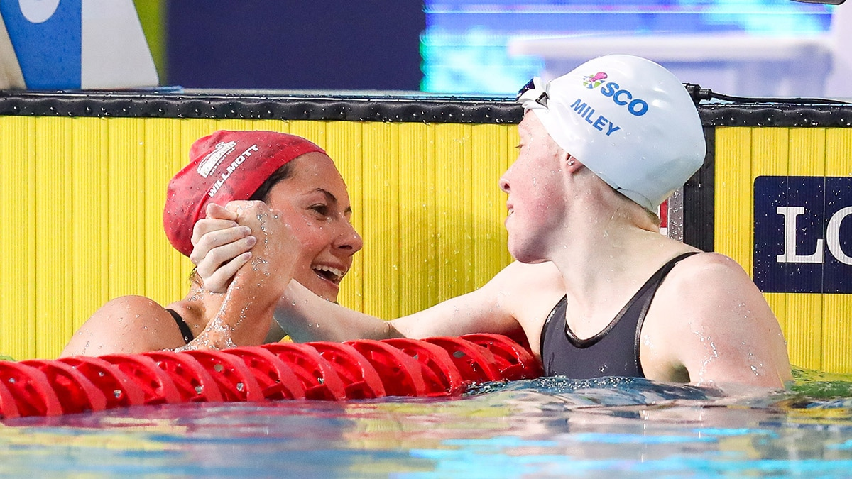 Aimee Willmott is congratulated by Hannah Miley after winning the 400m Individual Medley at the Gold Coast Commonwealth Games
