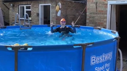 Masters swimmer Helen Davis paddling at home and keeping fit