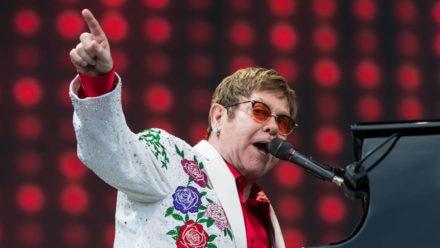 Sir Elton John sings praises of aqua fit as he 'walks six miles a week' in swimming pool