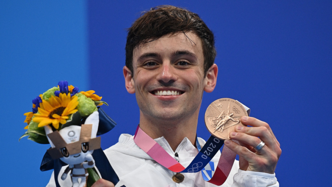Tom Daley makes history after adding a bronze medal to his glistening gold
