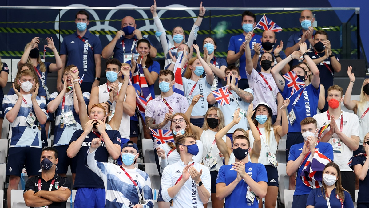 Team GB's swimmers cheer on the Men's Medley Really Team as they won silver at the Tokyo 2020 Olympic Games