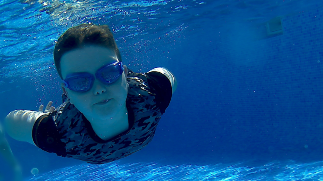 Mum and son inspire each other on 'very important' learn to swim journeys